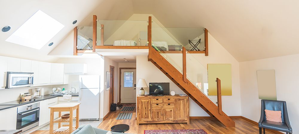 hardwood stairs with glass railing